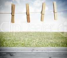 Clothespin on a laundry line outside above wooden boards