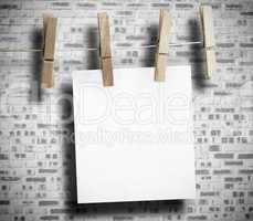 White paper hung with clothespin