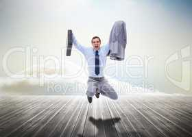 Stressed businessman jumping over wooden boards