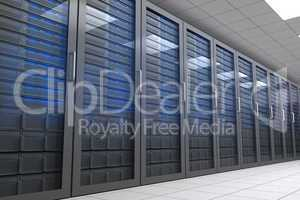 Hallway with row of tower servers