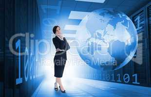 Businesswoman standing in data center with earth and binary code