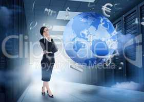Businesswoman standing in data center with earth and currency gr
