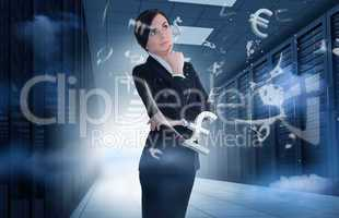 Businesswoman standing in data center with currency graphics