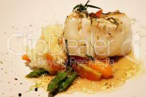 delicious Roasted fish with creamy sauce