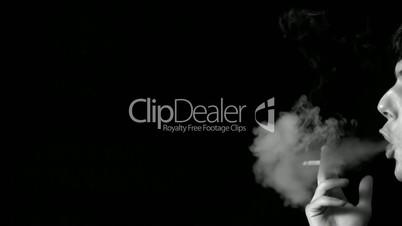 Man blowing out cigarette smoke