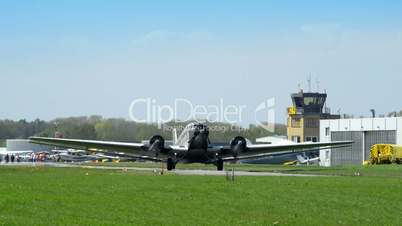 historic airplane Junkers JU 52 waiting on taxiway 10910