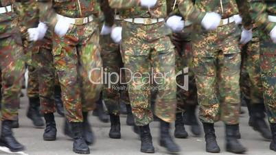 Formation of soldiers in dress parade uniform.