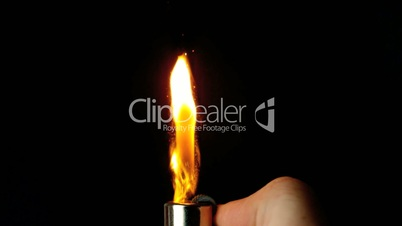 Hand lighting lighter with large flame and sparks