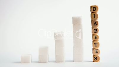 Towers of sugar cubes and dice spelling diabetes stacking up