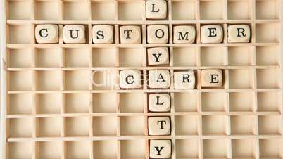 Customer care buzz words spelled out in dice and placed on grid