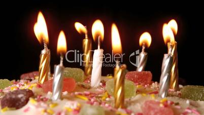Birthday Candles Being Blown Out On A Delicious Cake Close Up