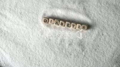 Dice spelling diabetes falling into pile of sugar