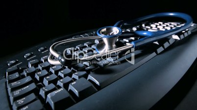 Stethoscope falling onto computer keyboard causing vibrations