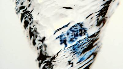Water whirlpool close up with blue ink