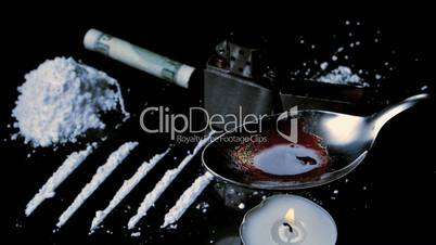Drugs cooking on a spoon with lines racked up and large pile