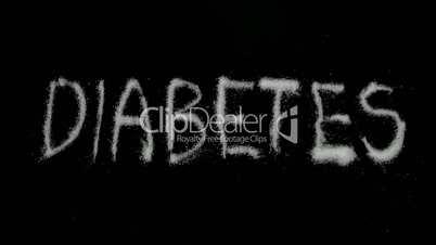 Diabetes spelled out in sugar blowing away in reverse