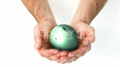 Sphere spinning in mans hands