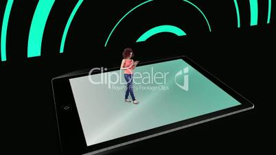 Girl walking on and using tablet pc with holographic application icons on black background