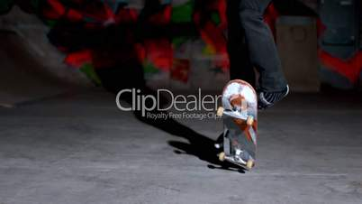 Front view of skater doing double kickflip trick