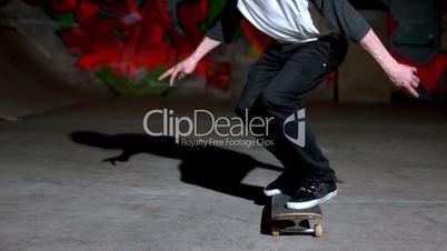 Front view of skater doing 360 flip