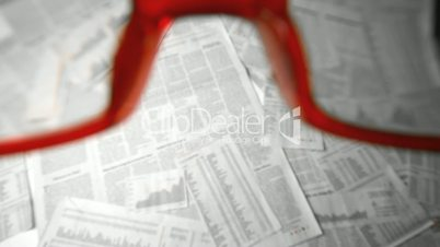 Glasses falling and bouncing on papers