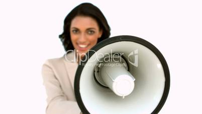 Businesswoman showing megaphone to the camera