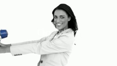 Businesswoman showing megaphone to the camera in black and white