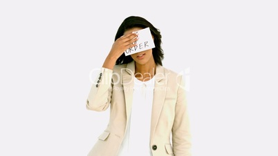 Exhausted businesswoman sticking out of order sign on her forehead