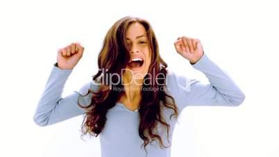 Pretty brunette cheering with joy