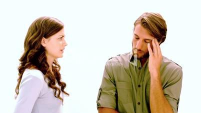 Girlfriend shouting at boyfriend as he rolls his eyes