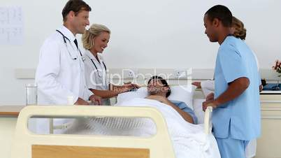 Medical team standing around patient