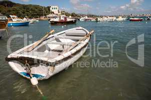 Beautiful small boat anchored in the port