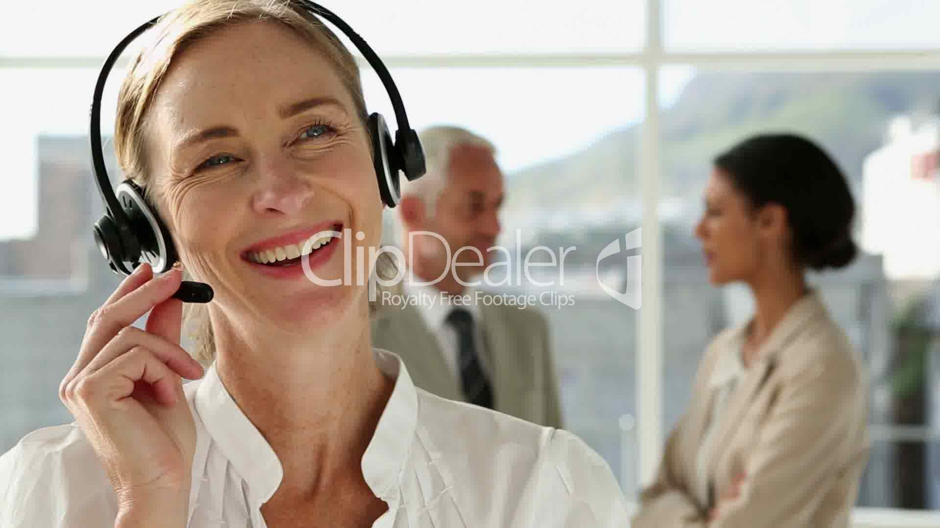 Businesswoman Talking On Headset Royalty Free Video And