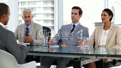 Job candidate talking to business people