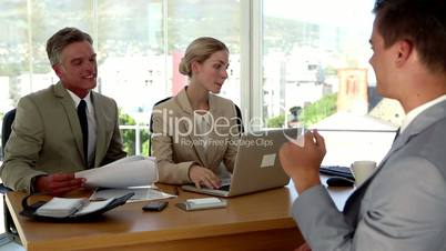 Businesswoman having a hot drink during a job interview