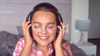Girl listening to music with headphone