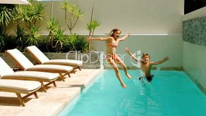 Siblings diving into the swimming-pool
