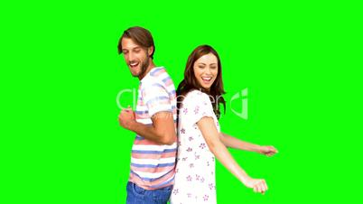 Friends dancing back to back on green screen