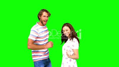 Two friends dancing together on green screen