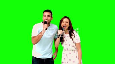 Friends dancing and singing on green screen