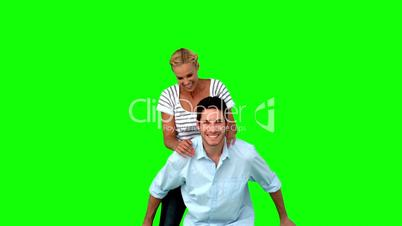 Man giving to his girlfriend a piggyback