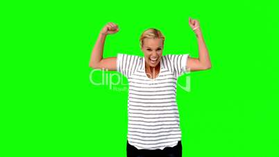 Blonde woman jumping against green screen