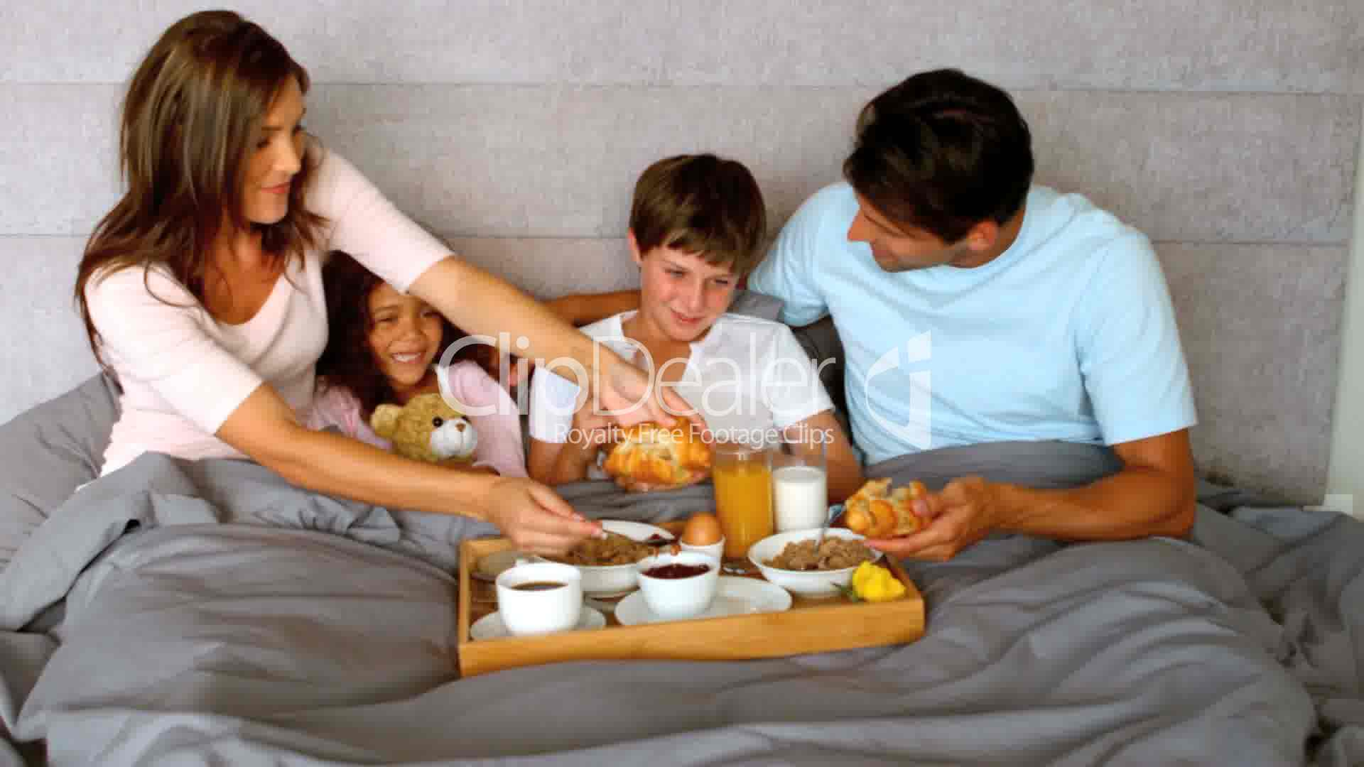 Family Having Breakfast In Bed Royalty Free Video And