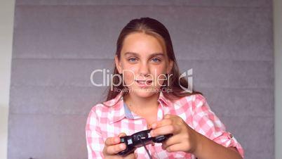 Girl playing at video game