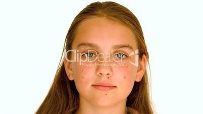 Girl smiling against white background