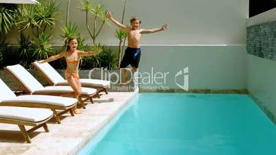Siblings diving into the swimming pool