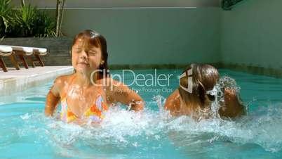 Siblings having fun in the swimming pool