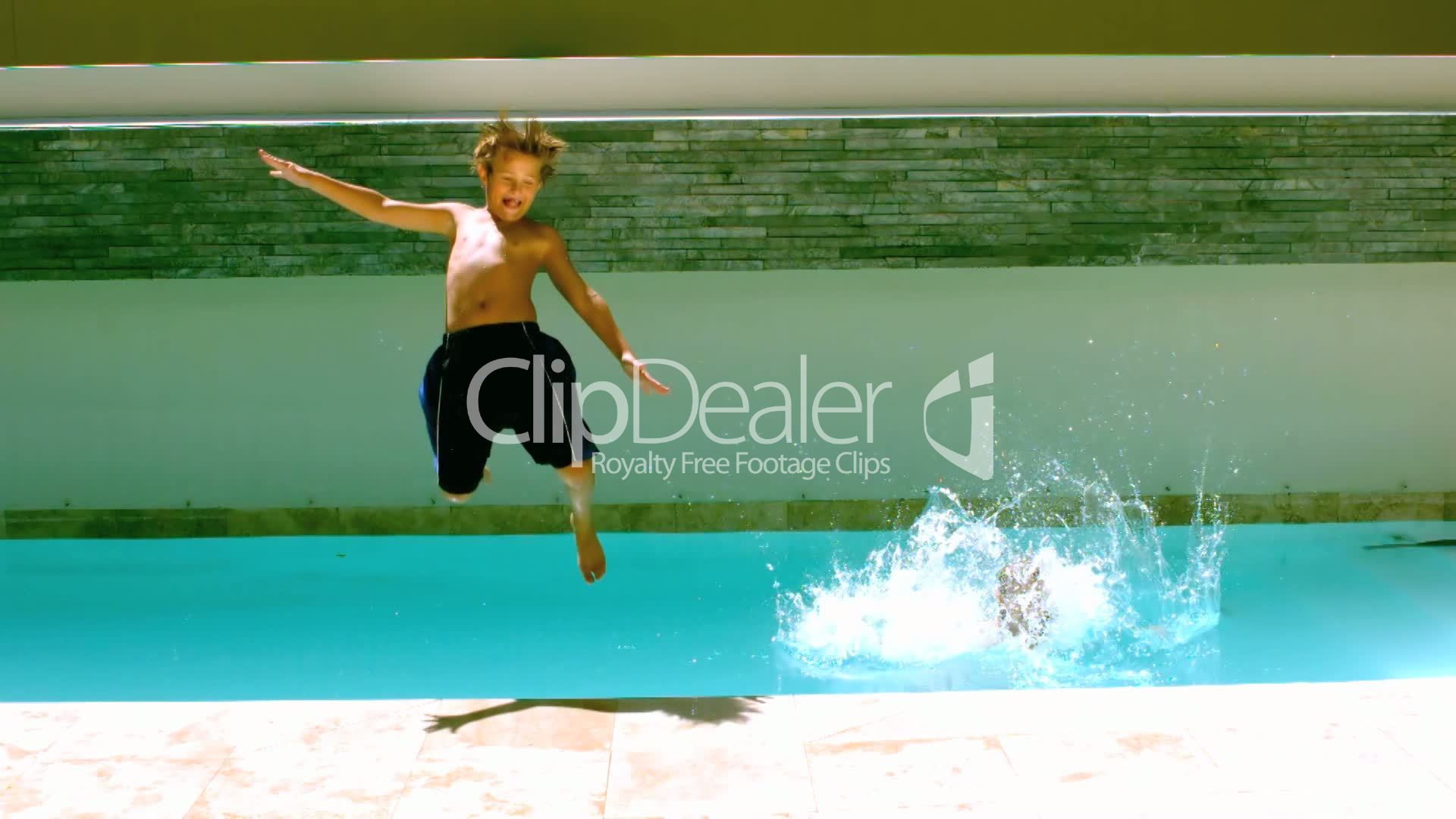 Siblings jumping together in the swimming pool: Royalty-free video