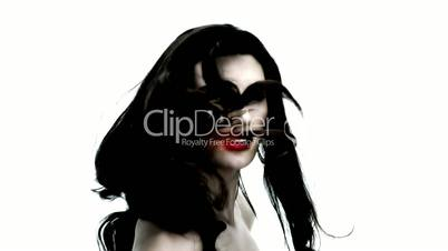 Young woman tossing her black hair