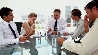 Boss pointing at employees at the meeting room